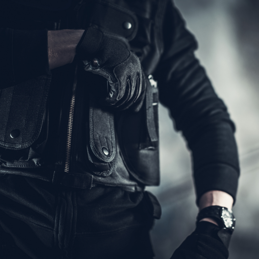 Armed Security Guard with hand on gun, ready to draw