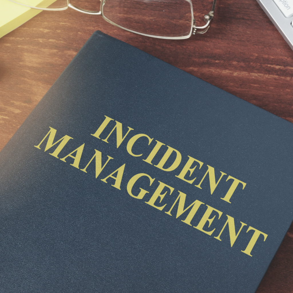 Incident Report Booklet Laying on Wooden Desk